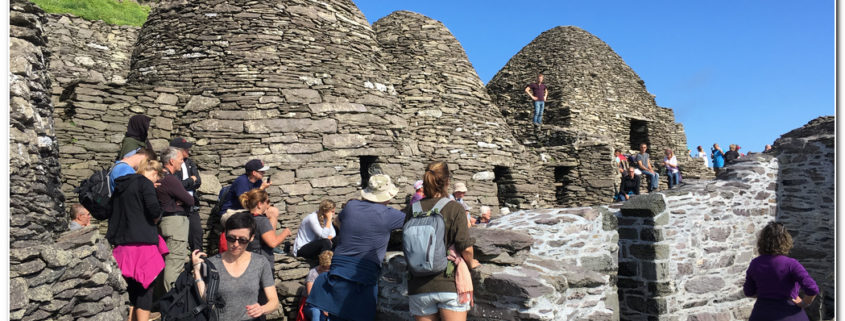 visitors at the beehive huts on skellig michael